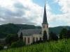 de St. Remigius kerk gezien vanaf de bovenliggende straat 'Auf Trommerst' (juli 2011)