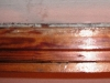 Metalen driehoekjes onder de stopverf (2009)